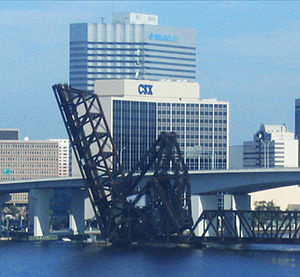 CSX's headquarters in Jacksonville, Florida, with the Florida East Coast Railway bridge in the foreground.