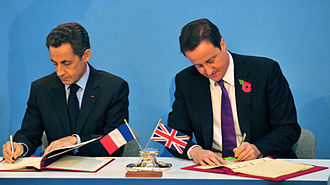 Lancaster House Treaties - Cameron and Sarkozy sign the Defence and Security Co-operation Treaty during the UK-France summit at Lancaster House, in London.