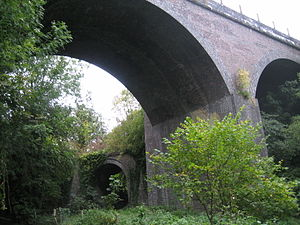 Bristol and North Somerset Railway - East-west beneath north-south: Camerton branch viaduct (left) dwarfed by Somerset and Dorset Joint Railway viaduct at Midford