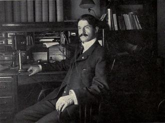 Charles A. Baird - Baird at his desk in Ann Arbor, c. 1903