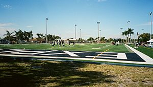 Christopher Columbus High School (Miami-Dade County) - The football field is surrounded by the track and stadium seating.
