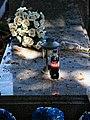 City of London Cemetery polished granite ledger slab stone disgarded Coca Cola bottle.jpg