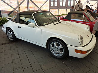Porsche - Porsche 911 (964), introduced in 1989, was the first to be offered with Porsche's Tiptronic transmission and four-wheel drive.