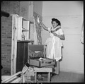 Closing of the Jerome Relocation Center, Denson, Arkansas. Mitzi Matsunaga packs her wardrobe just p . . . - NARA - 539631.tif