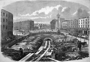 History of rapid transit - An engraving from the Illustrated London News showing the initial construction stages of London's Metropolitan Railway at King's Cross in 1861.