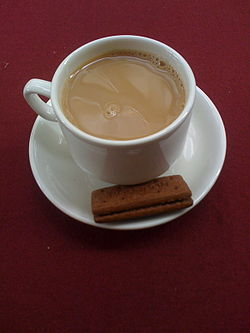 Cup of tea and bourbon biscuit.jpg