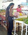 Customer makes purchase, Debe Market, Trinidad and Tobago.JPG