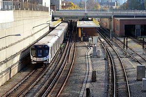 Davisville station - Northbound Toronto Rocket train, with Chaplin Crescent crossing above