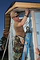 Defense.gov News Photo 100504-N-5208T-007 - U.S. Navy Seabees assigned to the Naval Mobile Construction Battalion 24 install siding at a Habitat for Humanity construction during a Birmingham.jpg