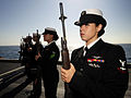 Defense.gov News Photo 110801-N-ZZ999-145 - Petty Officer 3rd Class Alexis Johnson serves as a member of the rifle guard aboard the aircraft carrier USS John C. Stennis CVN 74 during a burial.jpg