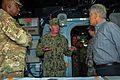 Defense Secretary Chuck Hagel, right, and Gen. Lloyd J. Austin III, commander, U.S. Central Command, left, listen to Vice Adm. John Miller, commander, U.S. Naval Forces Central Command, U.S. 5th Fleet, Combined 131206-N-IZ292-044.jpg