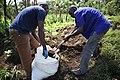 Deminers filling sandbags for tamping (22720512616).jpg