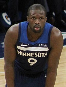 b33c78d6f45 Deng bending forward in the Timberwolves  navy blue uniform