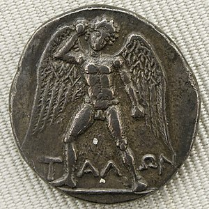 Talos - Winged 'ΤΑΛΩΝ' armed with a stone. Silver didrachma from Phaistos, Crete (ca. 300/280-270 BC), obverse. (Cabinet des Médailles, Paris)
