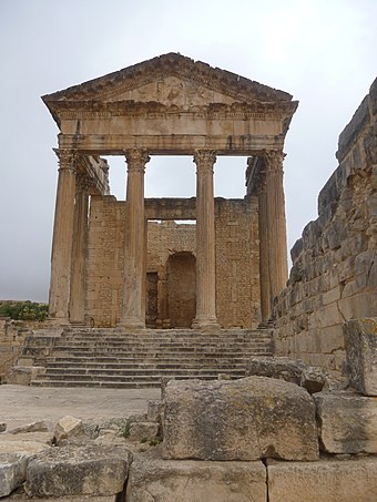 The front of the capitol at ruins of Dougga, another tourist destination, qualified as World Heritage Site by UNESCO in 1997. Dougga Thugga-130243.jpg