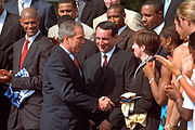 President George W. Bush congratulating Mike Krzyzewski and the 2001 champions at the White House.
