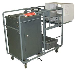 Electronic voting - A cart holding an ES&S M100 ballot scanner and an AutoMARK assistive device, as used in Johnson County, Iowa in 2010.