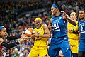 Erica Wheeler (17) defends the ball agains Maya Moore (23) and Sylvia Fowles (34) in the Lynx vs Fever game.jpg