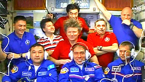 Aidyn Aimbetov - Aimbetov (bottom left), along with all aboard the space station (September 2015)