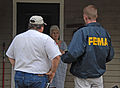FEMA - 30775 - FEMA Community Relations worker talking to a resident.jpg