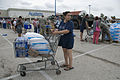FEMA - 38317 - Texas resident with ice and water in a shopping cart at a Texas POD site.jpg