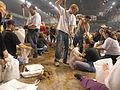 FEMA - 40287 - Residents fill sand bags at the Fargo Dome in North Dakota.jpg