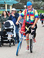 Festival of the Winds, XXXIX - Clown with unicycles - Bondi Beach, 2013.jpg