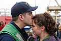 Flickr - Official U.S. Navy Imagery - Sailor kisses his wife after returning home..jpg