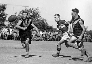 Australian rules football in the Northern Territory - A football match being played in Darwin in 1943.