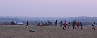 Culture of Uganda - Young boys playing a casual game of football (soccer) in Arua District.