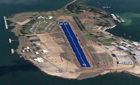 An island with building on the left and right. Center is a conceptual design of the runway covered in solar panels.