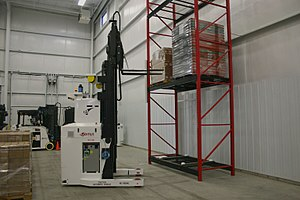 Automated guided vehicle - Forklift AGV picking load from rack (fully automated.)