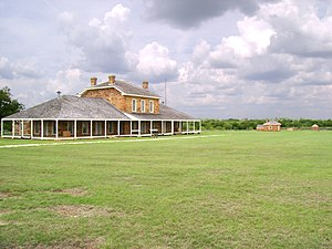 Fort Richardson (Texas) - Looking across Fort Richardson's parade ground toward the hospital.  The bakery, guardhouse and magazine are visible in the background.