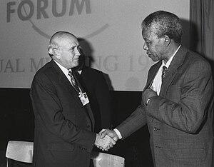 Frederik de Klerk and Nelson Mandela shake han...