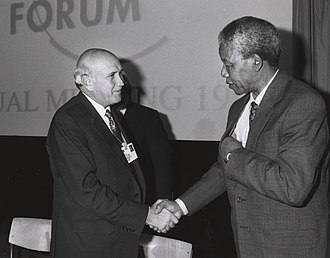 National Party (South Africa) - F. W. de Klerk shaking hands with ANC leader Nelson Mandela at the World Economic Forum in 1992
