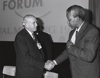 FW de Klerk and Nelson Mandela shake hands in January 1992 Frederik de Klerk with Nelson Mandela - World Economic Forum Annual Meeting Davos 1992.jpg