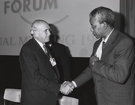 World Economic Forum, 1992: F. W. de Klerk (the last white minority president of South Africa) shakes hands with Nelson Mandela (who later became the first freely elected black president). Frederik de Klerk with Nelson Mandela - World Economic Forum Annual Meeting Davos 1992.jpg