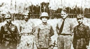 Free Thai Movement - M.L. Karb Kunjara (second from left) with American and Chinese military officers during his Free Thai operations in China.