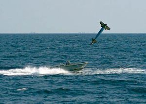 Laser-guided bomb - A GBU-10 shortly before it impacts a small boat during a training exercise