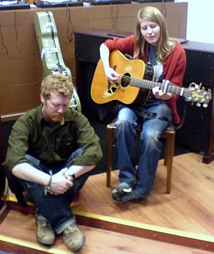 Glen Hansard - Hansard and Markéta Irglová playing at Cool Discs record store, Derry, Northern Ireland, April 2006