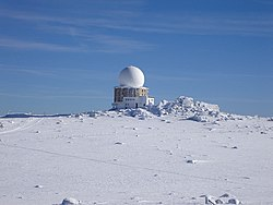 The Air Traffic Services facility on Golyam Rezen Peak from Cherni Vrah, Vitosha Mountain, Bulgaria. Photograph by Nikolay Rainov published in www.ImagesFromBulgaria.com under Creative Commons license 2.5.