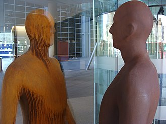 Antony Gormley - Pair of figures separated by plate glass, Regent's Place, London