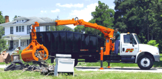 Bulky waste - Petersen Industries Lightning Loader grapple truck collecting bulky waste