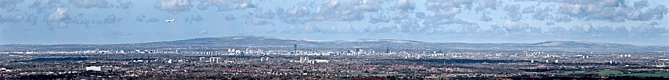 A view over Greater Manchester. The county is heavily urbanised and consists of vast built up areas and many settlements, fringed by sparsely populated countryside such as the West Pennine Moors.