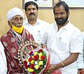 Gussadi Kanakaraju honored by Telangana State Culture Minister V. Srinivas Goud.jpg
