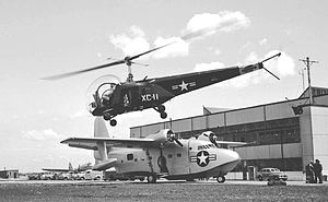 Floyd Bennett Field - A Bell HTL-1 taking off over a Grumman Albatross prototype at Floyd Bennett Field (May 1948)