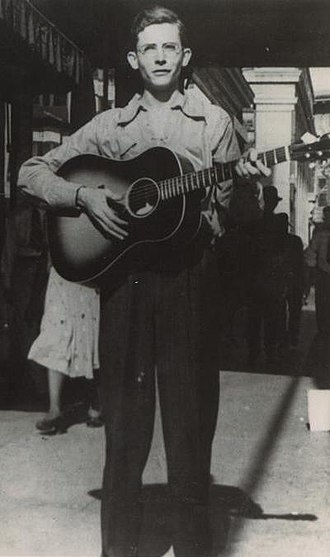 Hank Williams - Hank Williams playing guitar in Montgomery, Alabama in 1938