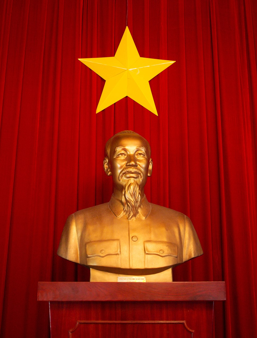 Ho Chi Minh statue and flag of Vietnam