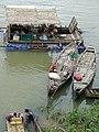 Houseboat, Fishing Boats, and Girl on Tonle Sekong Riverbank - Stung Treng - Cambodia (48444458881).jpg