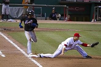José Reyes (infielder) - Reyes (left) running to first base in 2011